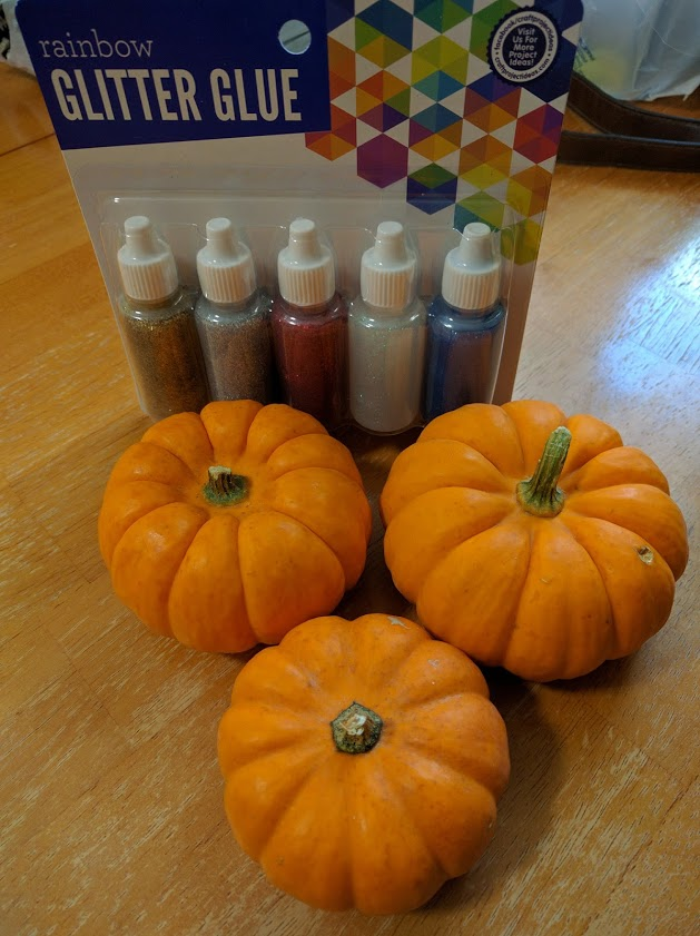 Pumpkin craft with glitter glue